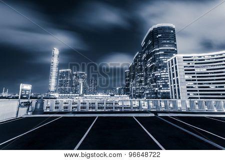 Modern city skyline and urban street at night