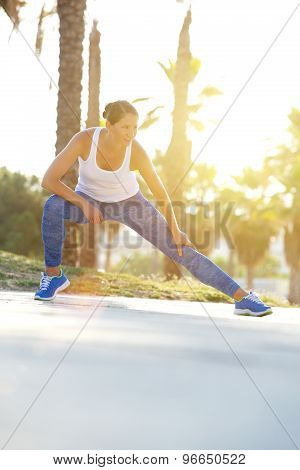 Woman Stretching Muscles After Workout