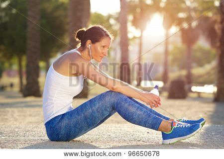 Tired Sports Woman Sitting Outside