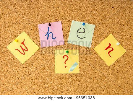 Cork board when written with pinned post it