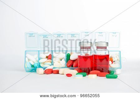 Injection Vials And Medicine In Weekly Pill Box