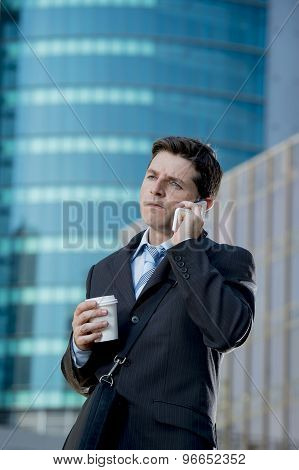 Businessman Talking On Mobile Phone Outdoors Financial District