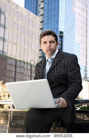 Businessman Holding Computer Laptop In Stress Outdoors On Financial District