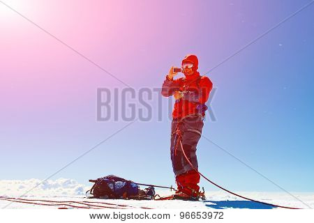 hiker at the top of a mount