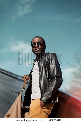 Fashion Elegant Young African Man Wearing A Black Leather Jacket With Bag In The City Over Evening S