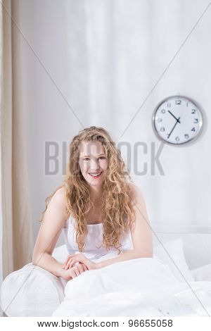 Content Female Relaxing In Bed