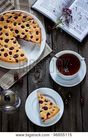 Cherry Pie On Old Grey Wooden Background.