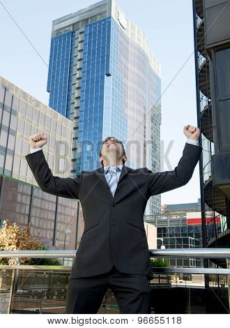 Successful Businessman Excited And Happy Doing Arm Winner Sign