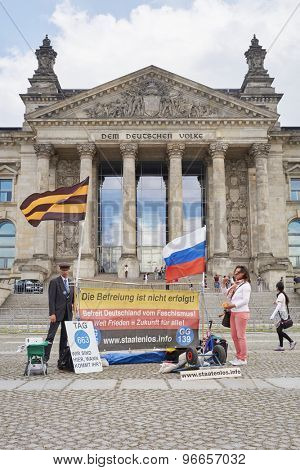 BERLIN, GERMANY - JULY 08: Protesters in front of Reichstag building. July 08, 2015 in Berlin.