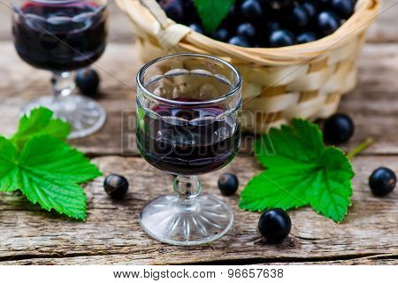 Liqueur From Blackcurrant In A Shot Glass