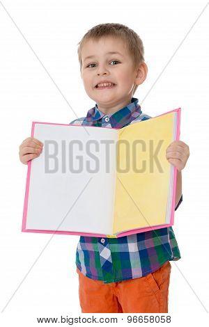 Little boy holding a book