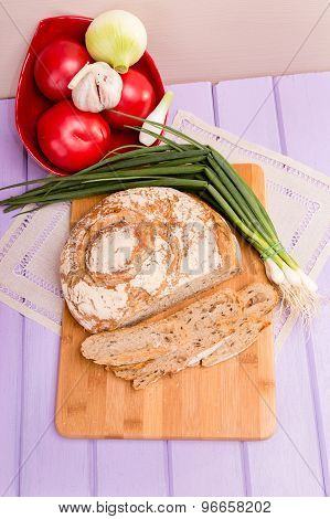 Loaf of bread on cutting board