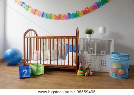 Wooden Cradle In Cosy Bedroom
