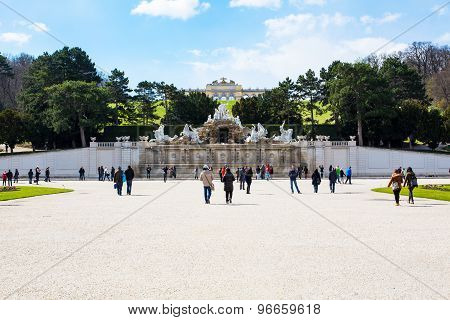 Tourists, Neptune Fountain And Gloriette At Schonbrunn, Vienna, Austria