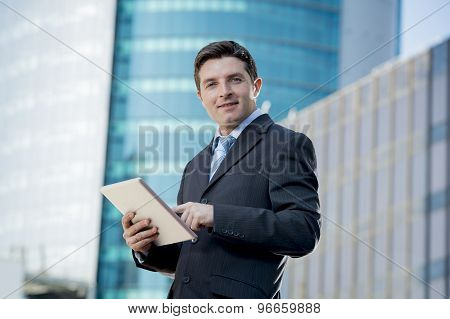 Businessman In Suit And Necktie Holding Digital Tablet Standing Outdoors Working Outdoors Business D