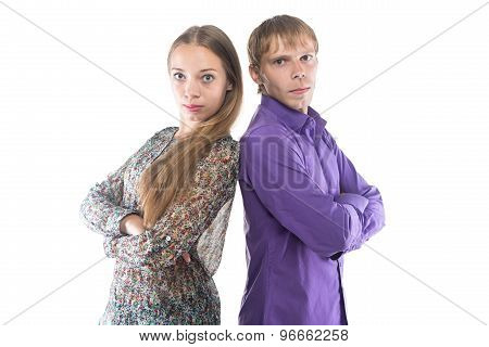 Photo of woman and man standing back-to-back