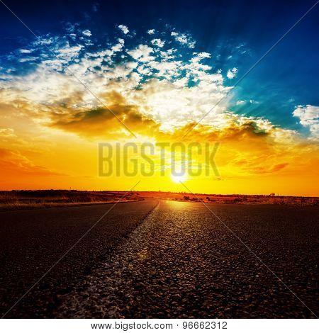 bright sunset and asphalt road to horizon