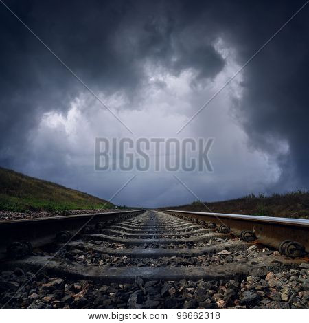 dramatic clouds over railroad to horizon