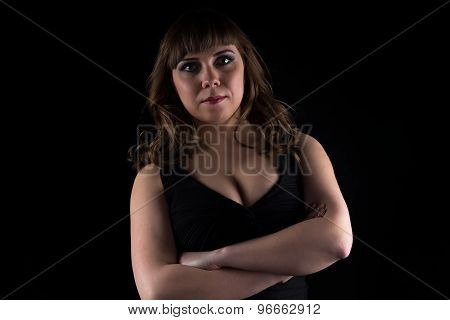 Photo of curvy woman with arms crossed