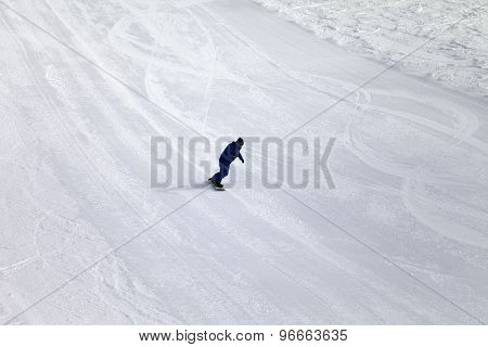 Ski Slope And Snowboarder At Sun Day