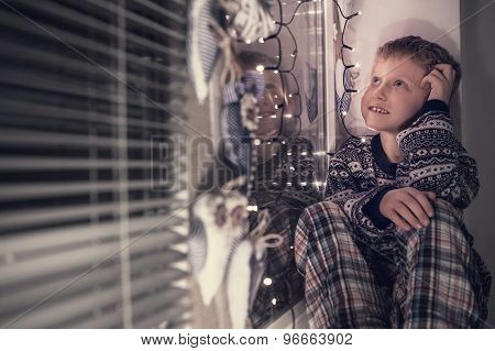 Little Boy Dreaming About Santa Presents