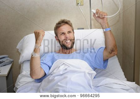 Angry Patient Man At Hospital Room Lying In Bed Pressing Nurse Call Button Feeling Nervous And Upset