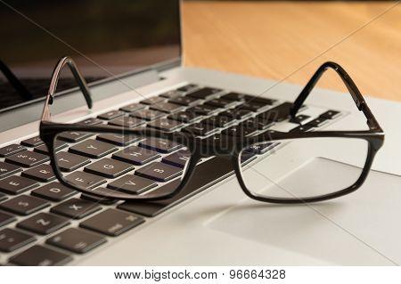 Glasses on a Keyboard