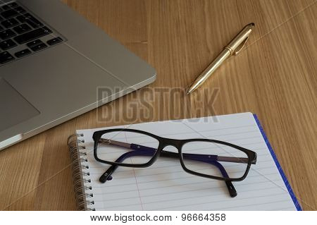 Glasses, Paper and Computer Keyboard