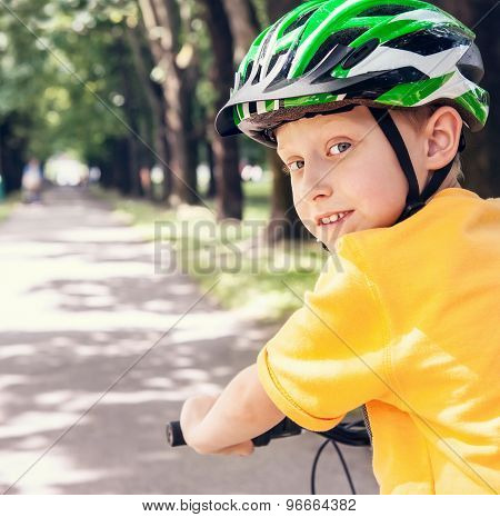 Boy In Safe Bicycle Helmet Close Up Portrait