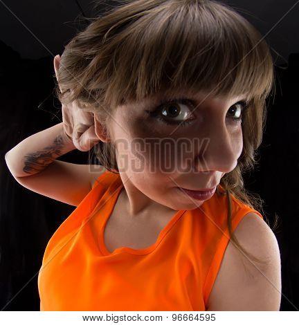 Photo of woman with hand near ear, fish eye