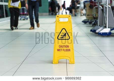 Yellow Sign That Alerts For Wet Floor.