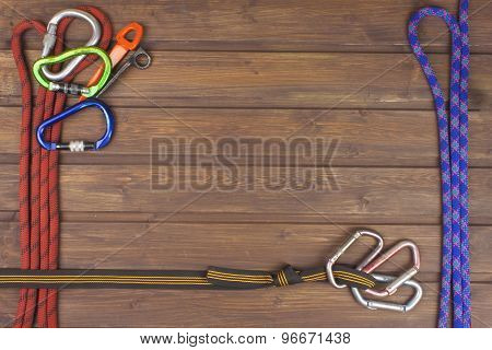 Used climbing gear on wooden background. Advertising boards of trade.