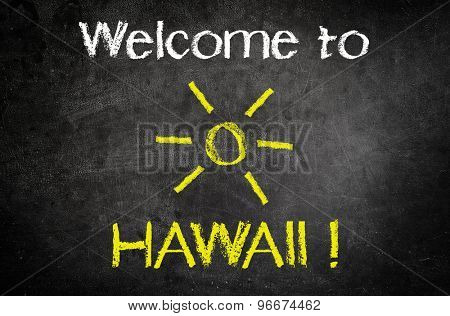 Welcome to Hawaii Message for Holiday Concept Written on a Black Chalkboard with Glowing Sun Drawing in the Middle of the Texts.