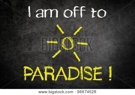 I am Off to Paradise Message for Summer Holiday Concept Written on a Black Vintage Chalkboard with Glowing Sun Drawing in the Middle of the Texts.
