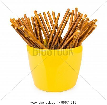 Salty Bread Sticks In Yellow Glass Cup Isolated On White