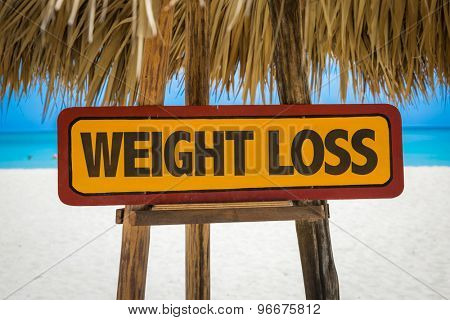 Weight Loss sign with beach background