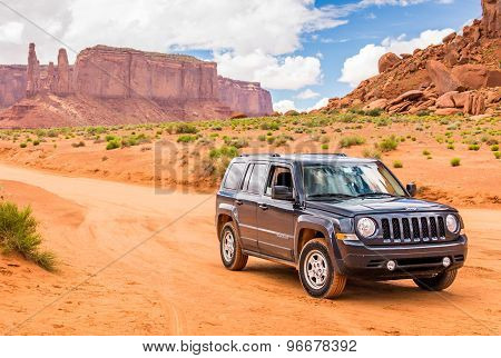 Monument Valley, Utah, Usa - May 25, 2015 - Offroading Through The Monument Valley In A Jeep Patriot