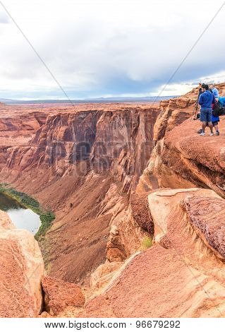 Page, Arizona - May 25: Hikers At Horseshoe Bend On May 25, 2015 In Page Az,usa. Thousands Of People