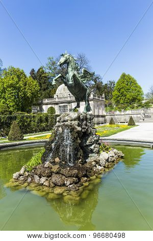Bronce Horse Statue In The Fountain Of The Mirabell Gardens
