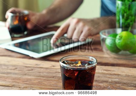 Full Glass Beaker Of Cola On A Wooden Table