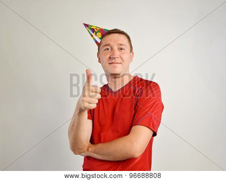 Party man closeup portrait with thumb up. birthday concept
