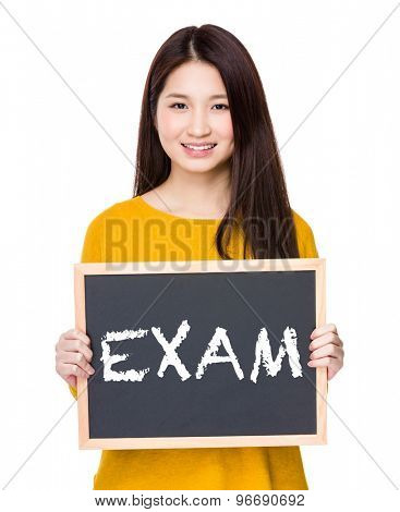 Woman hold blackboard showing a word exam