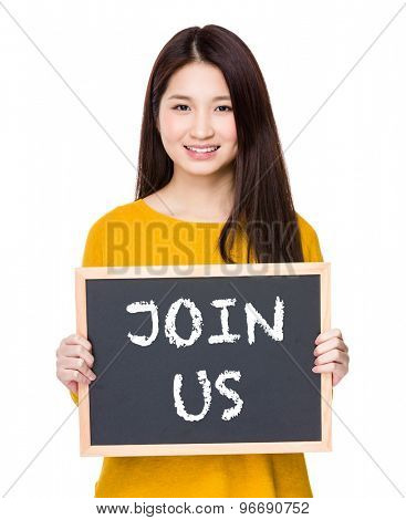 Woman hold blackboard showing a phrase of join us