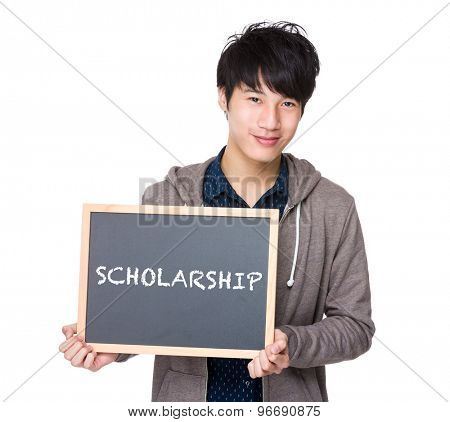 Asian young student with blackboard showing a word scholarship