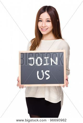 Woman hold with chalkboard showing a phrase of join us