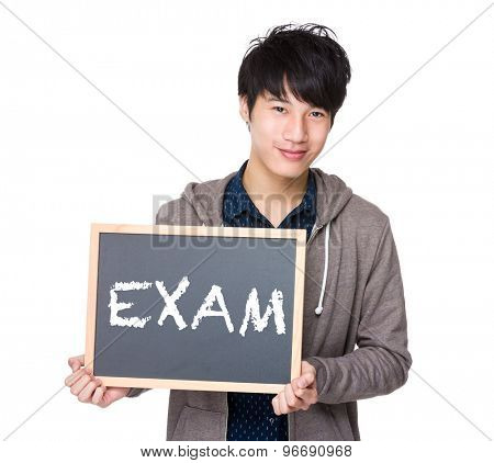 Asian young student with blackboard showing a word exam