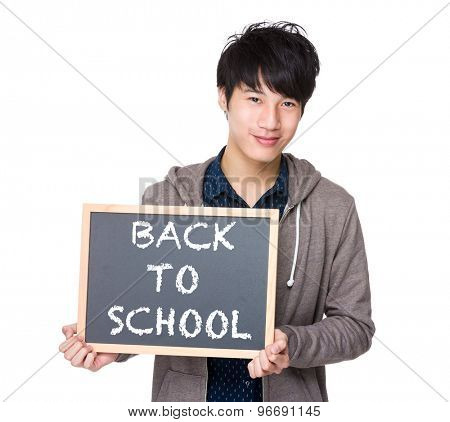 Asian young student with blackboard showing back to school