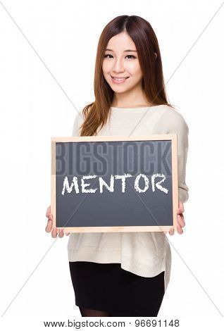 Woman hold with chalkboard showing a word mentor