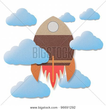 Space Rocket Flying In Space Cut Paper Craft On Paper Background.