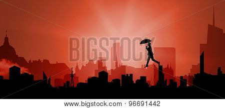 Businessman stepping with umbrella against cityscape silhouette